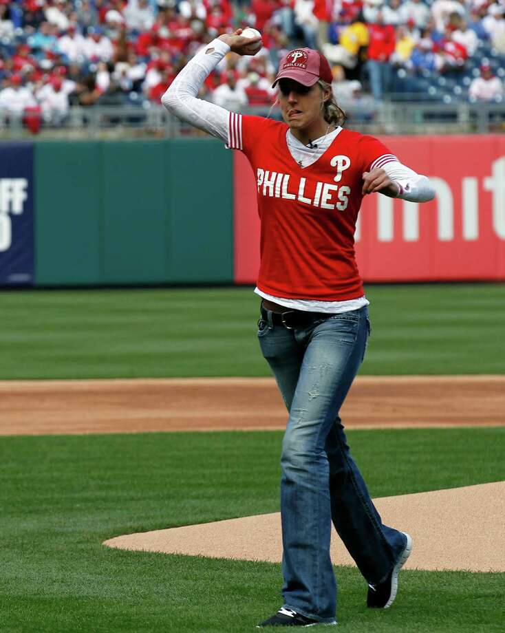 Delaware's Elena Delle Donne throws out the first pitch before the  home opener baseball game with the Philadelphia Phillies an the Miami Marlins Monday, April 9, 2012, in Philadelphia. Photo: AP