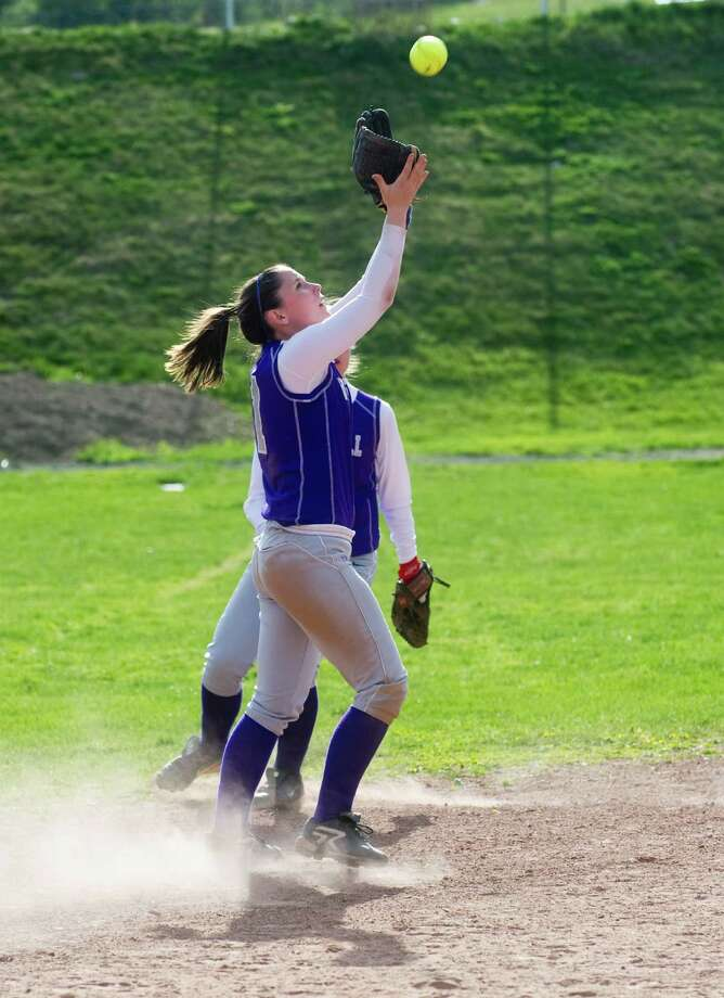 Westhill's Katie Brainard fields a pop fly as Westhill High School hosts Trumbull in a softball game in Stamford, Conn., April 9, 2012. Photo: Keelin Daly / Stamford Advocate
