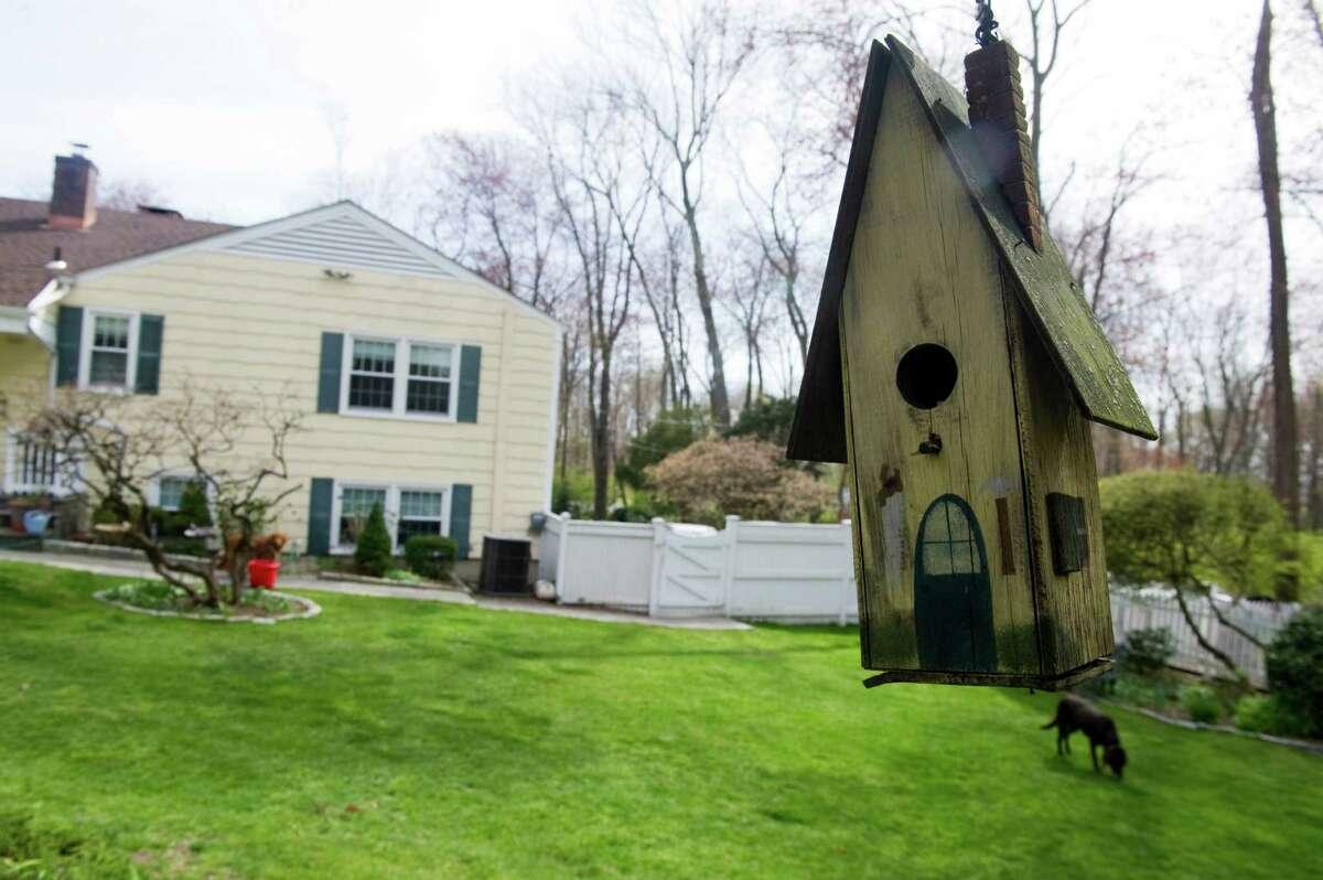 John and Dale Smyth have created an oasis on Newfield Drive in Stamford, Conn., April 9, 2012.