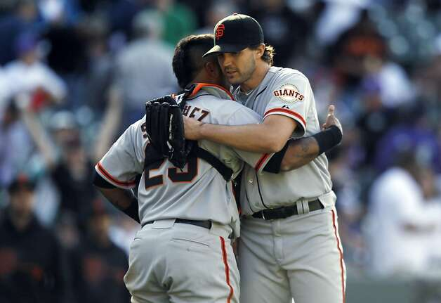 San Francisco Giants starting pitcher Barry Zito, right, hugs catcher Hector Sanchez after Zito retired Colorado Rockies' Todd Helton for the final out in the ninth inning of the Giants' 7-0 victory in a baseball game in Denver on Monday, April 9, 2012. (AP Photo/David Zalubowski) Photo: David Zalubowski, Associated Press