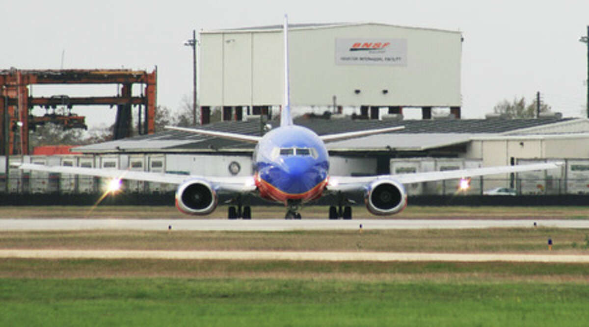A Southwest Airlines jet prepares for takeoff at Hobby Airport in December 2011.