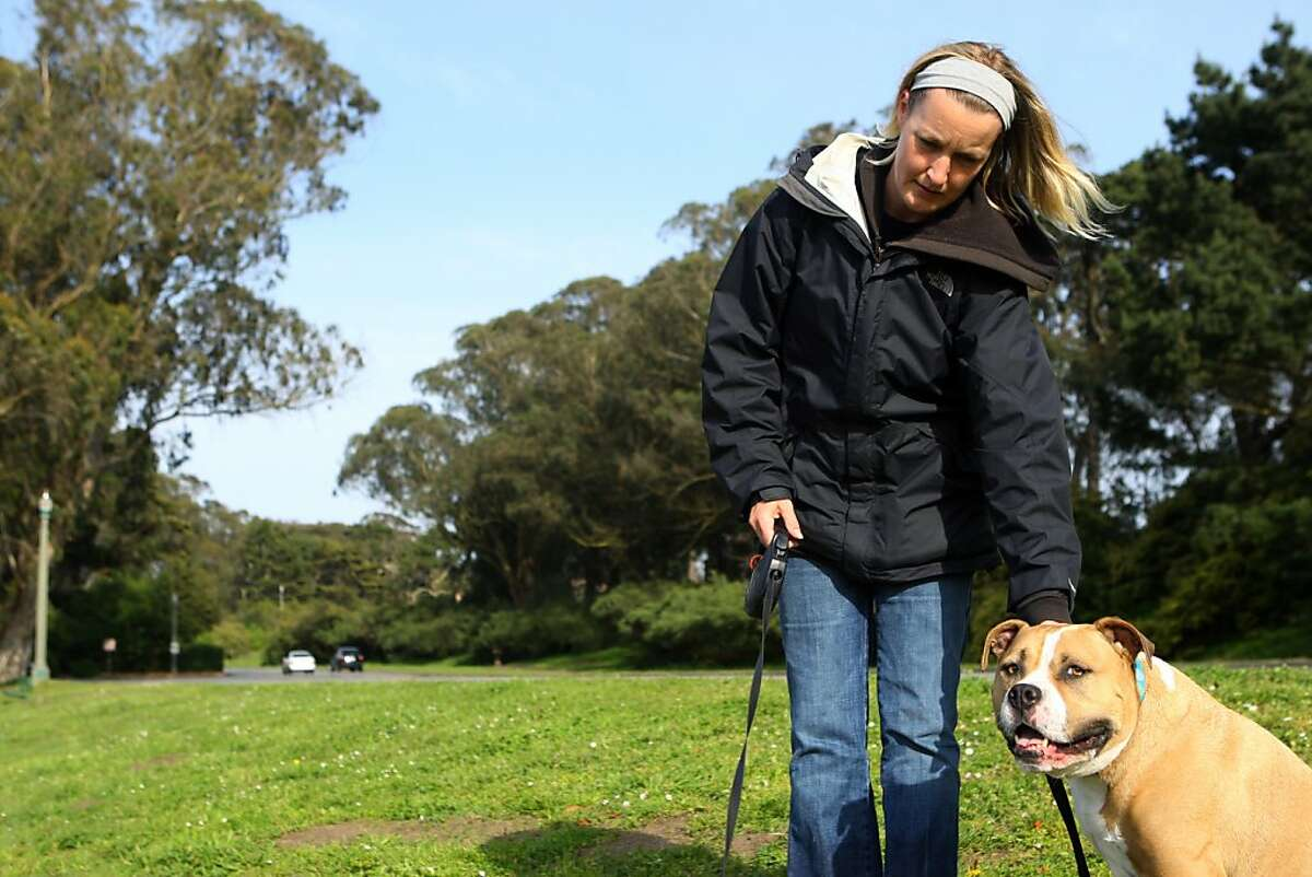 Haley Bratton walks her dogs in Golden Gate Park near the buffalo paddock on Monday, April 9, 2012. Bratton and her two dogs were confronted by a coyote during a morning walk on April 5th near the buffalo paddock.