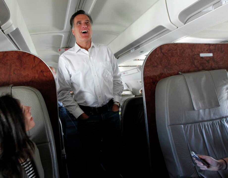 FILE - In this Feb. 1, 2012, file photo Republican presidential candidate, former Massachusetts Gov. Mitt Romney talks to reporters on his campaign plane en route from Tampa, Fla. to Minnesota and Nevada. Romney faces a daunting to-do list as he transitions into the role of likely Republican presidential nominee: raise more money, hire more people to work states critical in the fall race, hone his message for broad-spectrum appeal, while fending off GOP challengers who refuse to quit, thinking about a running mate, and refining a strategy to win the 270 electoral votes needed for the White House. (AP Photo/Gerald Herbert, File) Photo: Gerald Herbert