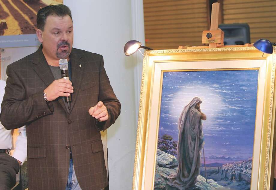 "FILE - In this Sept. 15, 2006 file photo, artist Thomas Kinkade unveils his painting, ""Prayer For Peace,"" at the opening of the exhibit ""From Abraham to Jesus,"" in Atlanta. Kinkade, whose brushwork paintings of idyllic landscapes, cottages and churches have been big sellers for dealers across the United States, died Friday, April 6, 2012, a family spokesman said. He was 54. (AP Photo/Gene Blythe, File) Photo: Gene Blythe, Associated Press"