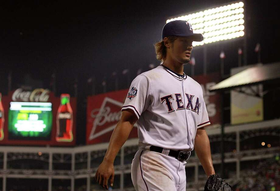 ARLINGTON, TX - APRIL 09:  Yu Darvish #11 of the Texas Rangers leaves the game in the sixth inning against the Seattle Mariners at Rangers Ballpark in Arlington on April 9, 2012 in Arlington, Texas. Photo: Ronald Martinez, Getty Images / 2012 Getty Images