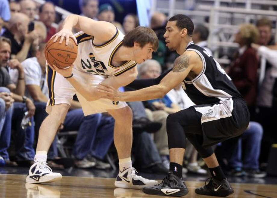 Utah Jazz guard Gordon Hayward (20) works against San Antonio Spurs guard Daniel Green during the first half of an NBA basketball game Monday, April 9, 2012, in Salt Lake City. (AP Photo/Jim Urquhart) (AP)
