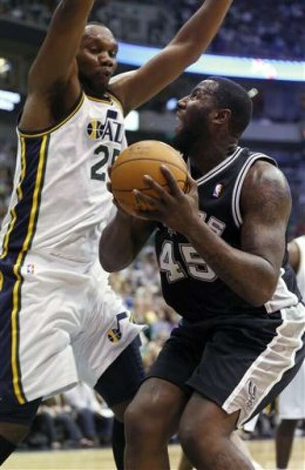 San Antonio Spurs forward DeJuan Blair (45) looks for a shot against Utah Jazz center Al Jefferson (25) during the first half of an NBA basketball game Monday, April 9, 2012, in Salt Lake City. (AP Photo/Jim Urquhart) (AP)
