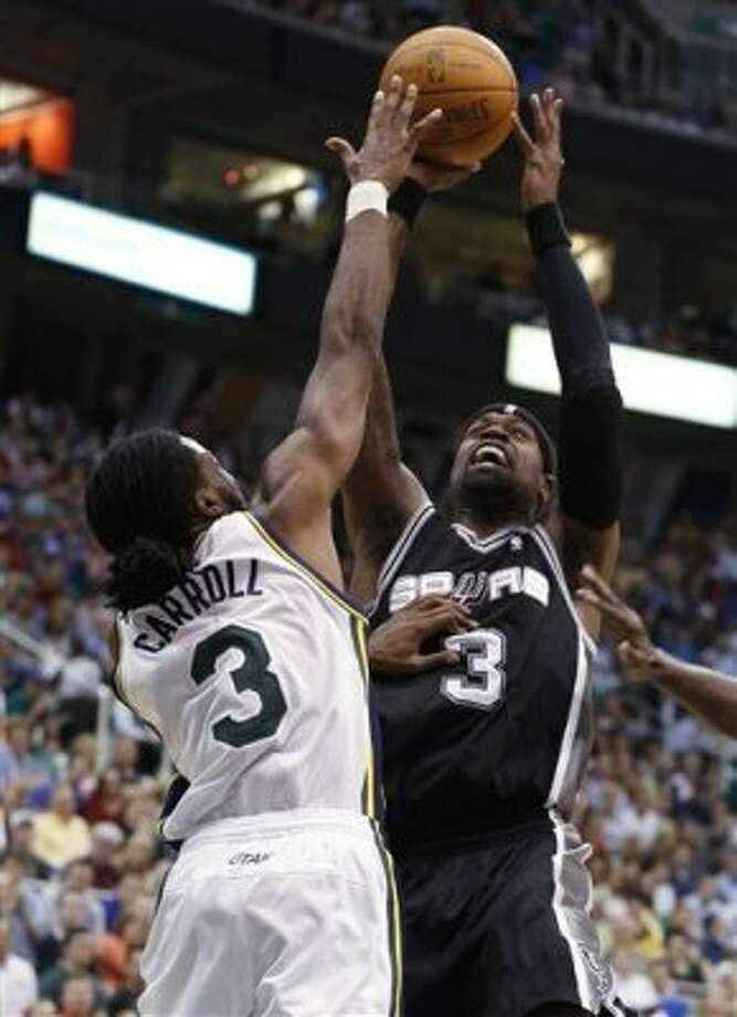 San Antonio Spurs guard Stephen Jackson (3) takes a shot over Utah Jazz forward DeMarre Carroll (3) during the first half of an NBA basketball game Monday, April 9, 2012, in Salt Lake City. (AP Photo/Jim Urquhart) (AP)