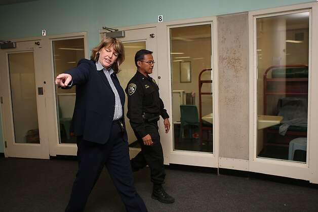 San Francisco Sheriff Vicki Hennessy touring county jail 2 in San Francisco, Calif., with Lieutenant Cabebe (back) on Monday, April 9, 2012. Photo: Liz Hafalia, The Chronicle
