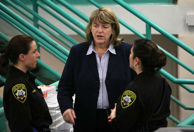 San Francisco Sheriff Vicki Hennessy talks with staff while touring the county jail in San Francisco, Calif.,  on Monday, April 9, 2012. Photo: Liz Hafalia, The Chronicle