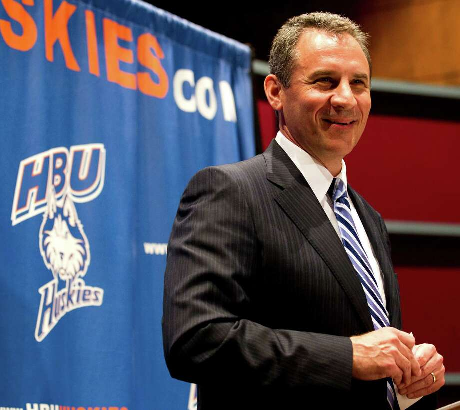 Vic Shealy is all smiles as he is introduced as Houston Baptist's first football coach Monday. The Huskies plan to begin play in the Southland Conference in 2014. Photo: Brett Coomer / © 2012 Houston Chronicle