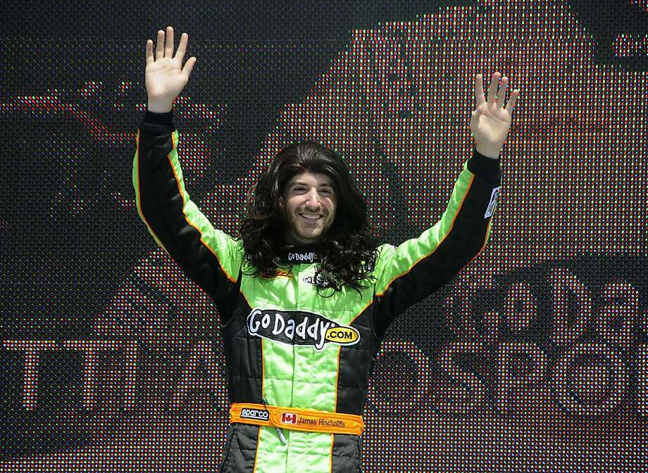 James Hinchcliffe waves while wearing a wig during driver introductions for the IndyCar Series' Honda Grand Prix auto race in St. Petersburg, Fla., on Sunday, March 25, 2012. Hinchcliffe replaced Danica Patrick at Andretti Autosport. (AP Photo/LAT, Paul Webb) Photo: Paul Webb, Associated Press