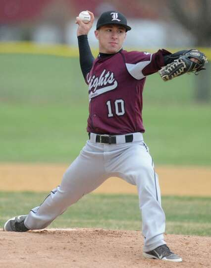 Lansingburgh's Bob Gould pitches the ball during a baseball game against Shaker April 9, 2012 in Tro