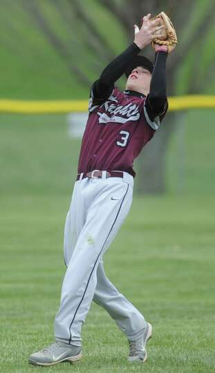 Lansingburgh's Andrew Cooper catches a fly ball during a baseball game against Shaker April 9, 2012
