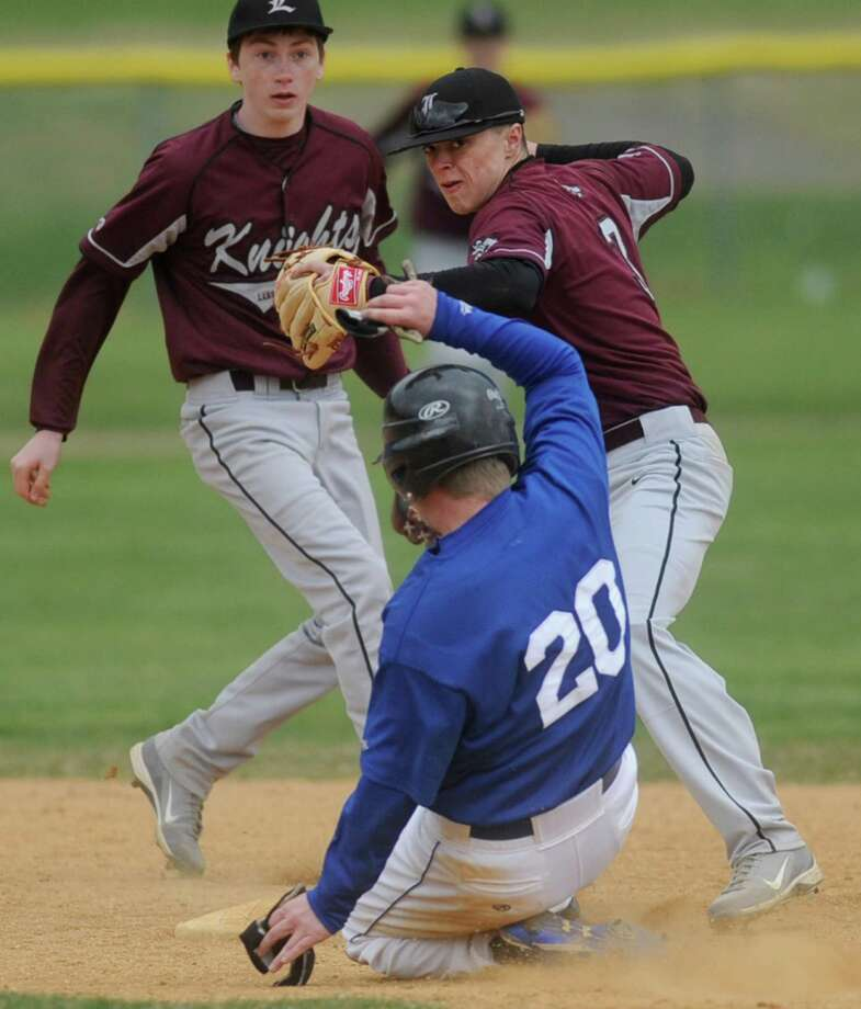 Lansingburgh's Andrew Cooper gets Shaker's Andrew Brochu out at second base as he tries to turn a double play during a baseball game against Shaker April 9, 2012 in Troy, N.Y. (Lori Van Buren / Times Union) Photo: Lori Van Buren
