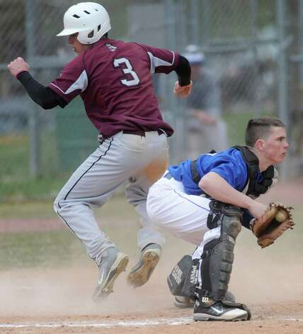Lansingburgh's Andrew Cooper is safe at home as Shaker catcher Brenden Killian doesn't get the ball in time during a baseball game April 9, 2012 in Troy, N.Y. (Lori Van Buren / Times Union) Photo: Lori Van Buren