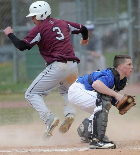 Lansingburgh's Andrew Cooper is safe at home as Shaker catcher Brenden Killian doesn't get the ball