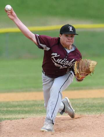 Lansingburgh's #8 (no first name on roster) Holland pitches the ball during a baseball game against Shaker April 9, 2012 in Troy, N.Y. (Lori Van Buren / Times Union) Photo: Lori Van Buren