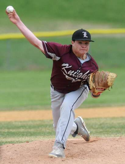 Lansingburgh's #8 (no first name on roster) Holland pitches the ball during a baseball game against