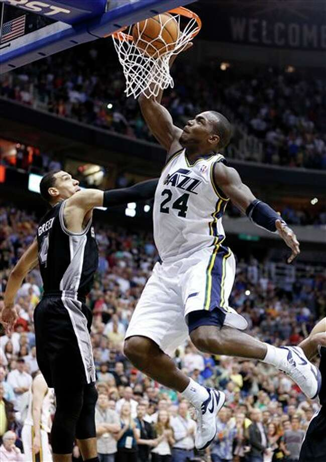 Utah Jazz forward Paul Millsap (24) dunks in front of San Antonio Spurs guard Daniel Green (4) during the second half of an NBA basketball game Monday, April 9, 2012, in Salt Lake City. The Jazz won 91-84. (AP Photo/Jim Urquhart) Photo: Associated Press