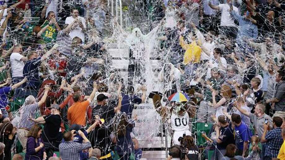 Fan participate in a Silly String fight during the second half of an NBA basketball game between the Utah Jazz and the San Antonio Spurs on Monday, April 9, 2012, in Salt Lake City. The Jazz won 91-84. (AP Photo/Jim Urquhart) (AP)