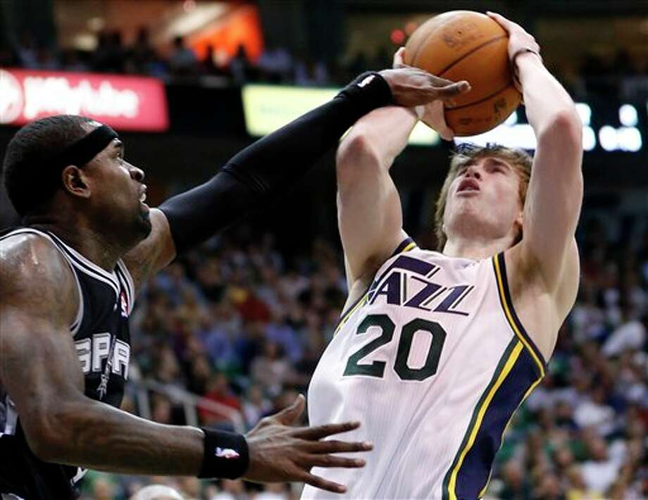 Utah Jazz guard Gordon Hayward (20) takes a shot while defended by San Antonio Spurs guard Stephen Jackson during the second half of an NBA basketball game Monday, April 9, 2012, in Salt Lake City. The Jazz won 91-84. (AP Photo/Jim Urquhart) (ASSOCIATED PRESS)