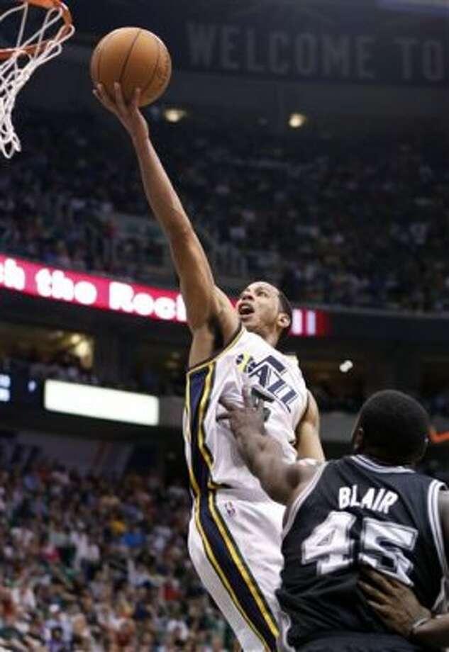 Utah Jazz guard Devin Harris (5) drives past San Antonio Spurs forward DeJuan Blair (45) for a shot during the second half of an NBA basketball game Monday, April 9, 2012, in Salt Lake City. The Jazz won 91-84. (AP Photo/Jim Urquhart) (AP)