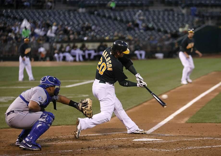 Josh Donaldson hits an RBI single in the bottom of the second. The Oakland Athletics played the Kansas City Royals on Monday, April 9, 2012. Photo: Sean Culligan, The Chronicle