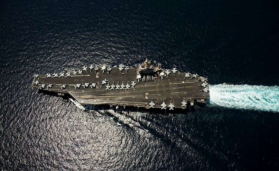 """Nimitz-class aircraft carrier USS Abraham Lincoln (CVN 72) transits through the Arabian Sea on April 5, 2012. The United States is keeping the pressure on Iran with the presence of two aircraft carriers close to the Gulf region ahead of the resumption of nuclear talks with Tehran this week. """"There are currently two carrier strike groups in the US 5th Fleet area of operations,"""" Lieutenant Commander John Fage, a navy spokesman, said April 9, 2012.Abraham Lincoln is deployed to the US 5th Fleet area of responsibility conducting maritime security operations, theater security cooperation efforts and support missions as part of Operation Enduring Freedom.      AFP PHOTO/HANDOUT/US NAVY/Mass Communication Specialist Seaman Apprentice Karolina A. Martinez (Photo credit should read HO/AFP/Getty Images) Photo: Ho, AFP/Getty Images"""