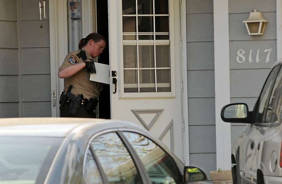 A police officer investigates the scene where three people were shot and killed at an in-home day care in Brooklyn Park,  Minn., on Monday, April 9, 2012. No arrests were immediately made. (AP Photo/The Star Tribune, Richard Sennott)  MANDATORY CREDIT; ST. PAUL PIONEER PRESS OUT; MAGS OUT; TWIN CITIES TV OUT Photo: Richard Sennott, Associated Press
