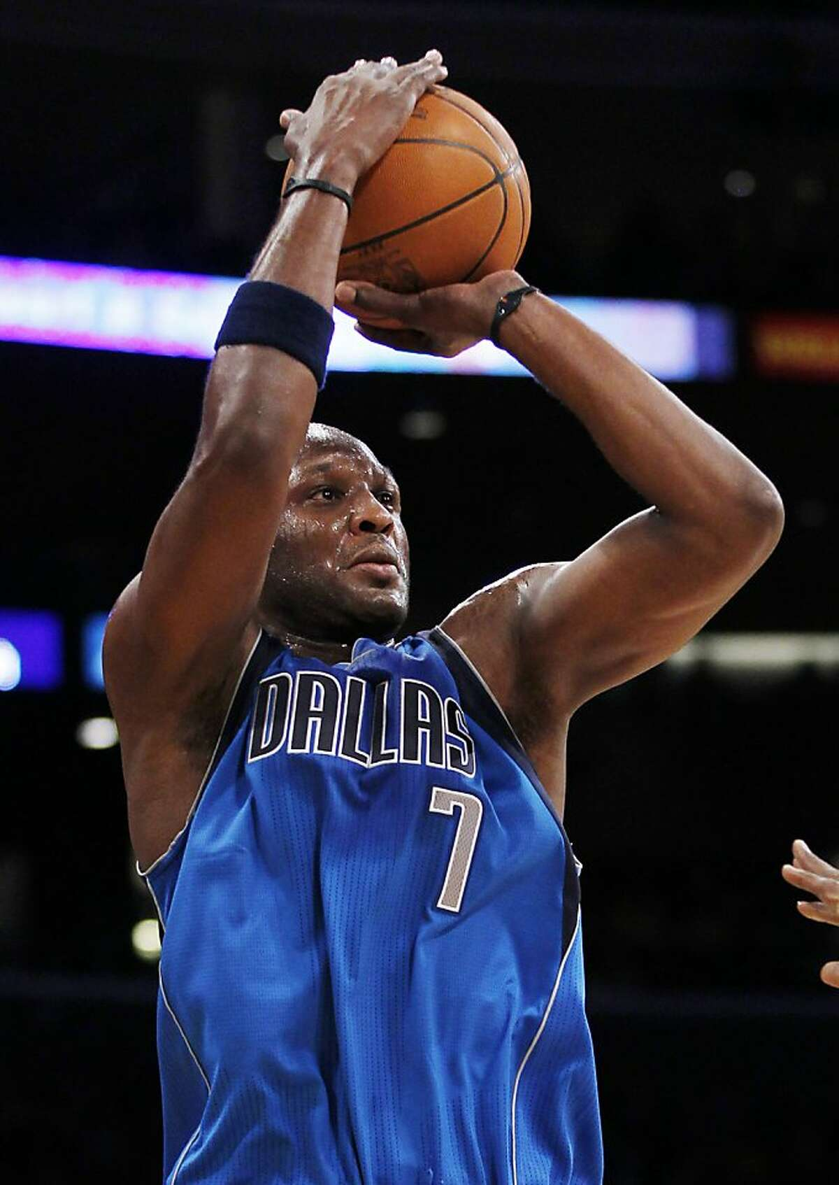 FILE - This Jan. 16, 2012 file photo shows Dallas Mavericks' Lamar Odom makin g a three-point shot against the Los Angeles Lakers during the first quarter of an NBA basketball game in Los Angeles. The NBA's reigning Sixth Man of the Year, who was shipped to Dallas after the Los Angeles Lakers tried to send him to New Orleans in the Chris Paul deal that was nixed by the league, will not play the rest of the season for the Mavericks, according to a person familiar with the decision who spoke Monday, April 9, 2012, on condition of anonymity because an official announcement had not been made. (AP Photo/Danny Moloshok, File)