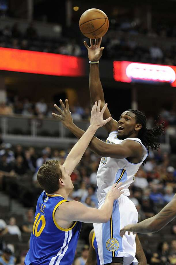 Denver Nuggets forward Kenneth Faried (35)  goes up for a jump hook over Golden State Warriors power forward David Lee (10) Monday, April 9, 2012 at Pepsi Center in Denver, Colo. (AP Photo/The Denver Post, John Leyba) Photo: John Leyba, Associated Press