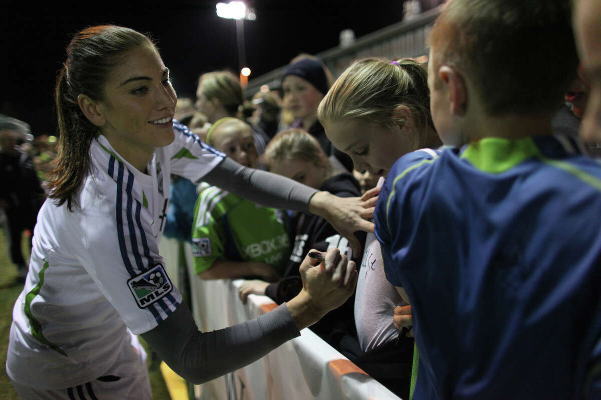 Seattle Sounders player Hope Solo signs autographs during the Sounders women season opener on Monday, April 9, 2012 at Starfire Sports Stadium in Tukwila.