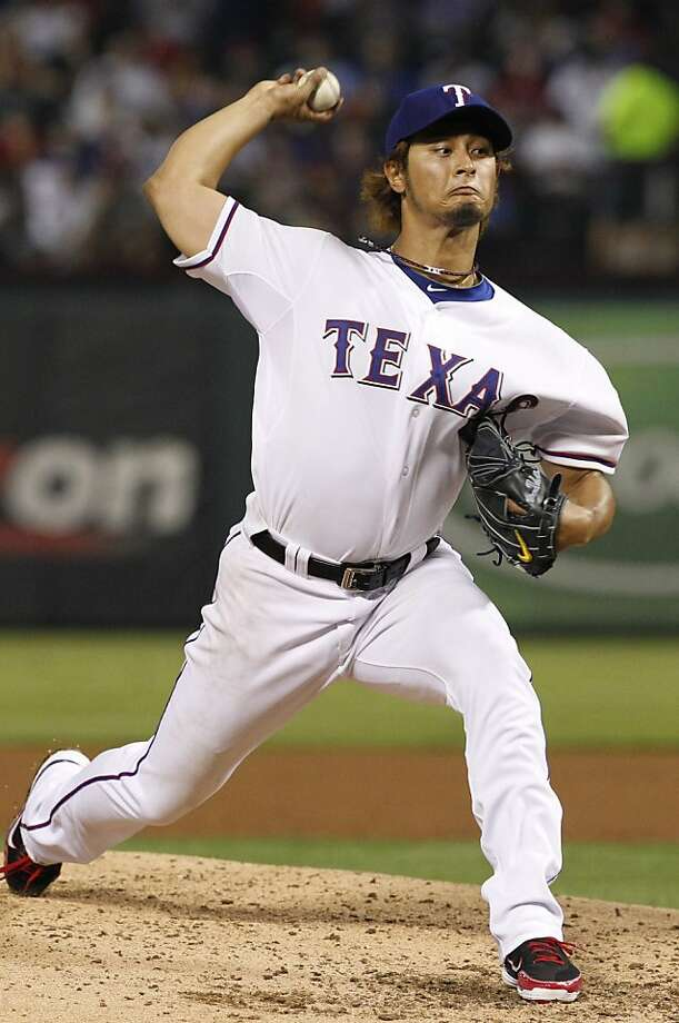 Texas Rangers starting pitcher Yu Darvish (11) of Japan delivers during the second first inning of a baseball game against the Seattle Mariners Monday, April 9, 2012 in Arlington, Texas. (AP Photo/Tony Gutierrez) Photo: Tony Gutierrez, Associated Press
