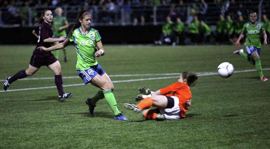 Seattle Sounders women player Alex Morgan goes up against Seattle Pacific University keeper Natalie Harold during the Sounders women season opener on Monday, April 9, 2012 at Starfire Sports Stadium in Tukwila. Photo: JOSHUA TRUJILLO / SEATTLEPI.COM