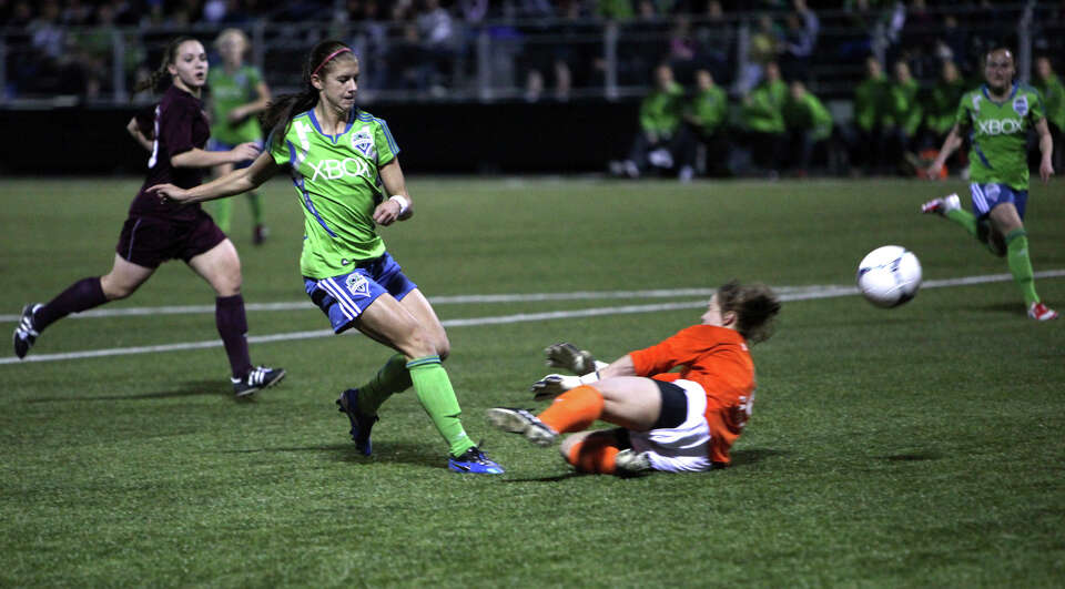 Seattle Sounders women player Alex Morgan goes up against Seattle Pacific University keeper Natalie