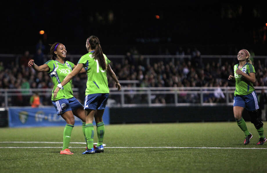 Seattle Sounders women player Alex Morgan is hugged by teammate Sydney Leroux, left, after Morgan scored a goal against Seattle Pacific University during the Sounders women season opener on Monday, April 9, 2012 at Starfire Sports Stadium in Tukwila. Photo: JOSHUA TRUJILLO / SEATTLEPI.COM