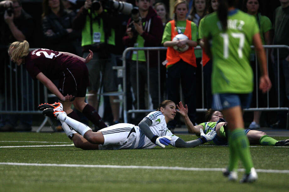Seattle Sounders women player Hope Solo goes down after a collision near the goal during play against Seattle Pacific University on Monday, April 9, 2012 at Starfire Sports Stadium in Tukwila. Photo: JOSHUA TRUJILLO / SEATTLEPI.COM