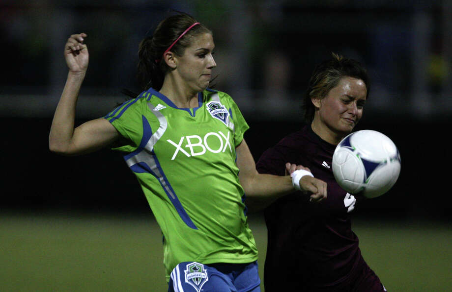 Seattle Sounders women player Alex Morgan battles against Seattle Pacific University Andrea Chan during the Sounders women season opener on Monday, April 9, 2012 at Starfire Sports Stadium in Tukwila. Photo: JOSHUA TRUJILLO / SEATTLEPI.COM