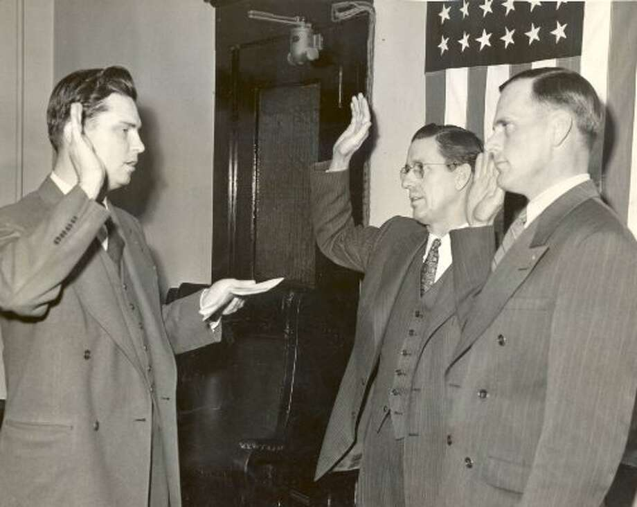 Harris County Judge Roy Hofheinz, left, with Constable Ray Wooley and Sheriff Neal Polk, 1942. (File / Houston Chronicle)