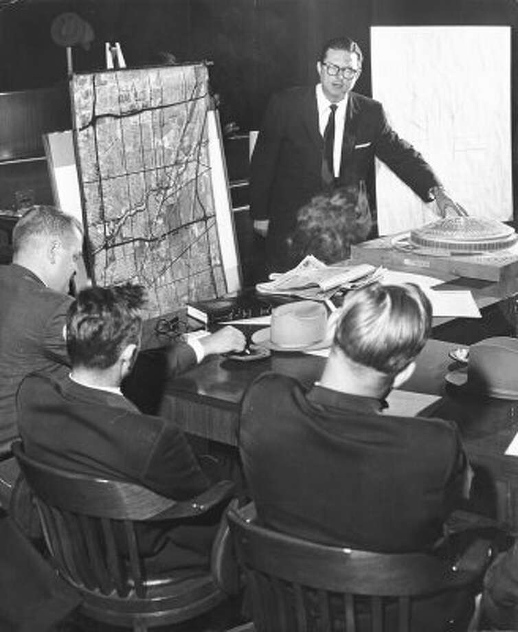Former Houston mayor Roy Hofheinz makes a pitch to state Reps. Paul Floyd, Criss Cole, and W. H. Miller for building the Domed Stadium, 1961. (Dan Hardy / Houston Post)