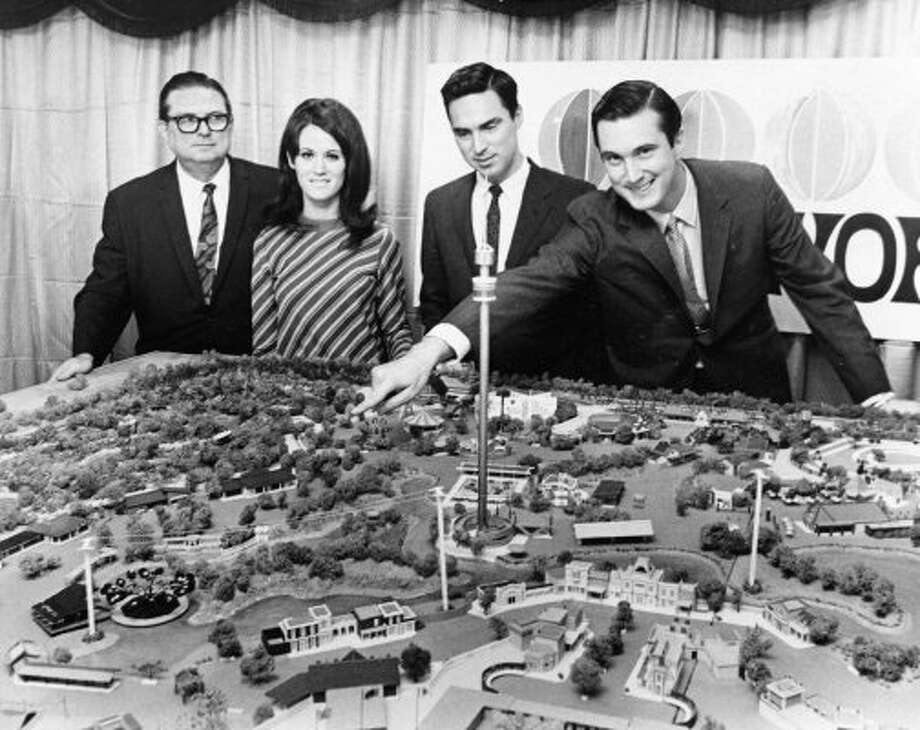 The Hofheinz family looks over a model of Astroworld in 1967. From left, Roy Hofheinz and his children, Dene Hofheinz Mann, Roy Hofheinz Jr., and Fred Hofheinz. (Tom Colburn / Houston Chronicle file)