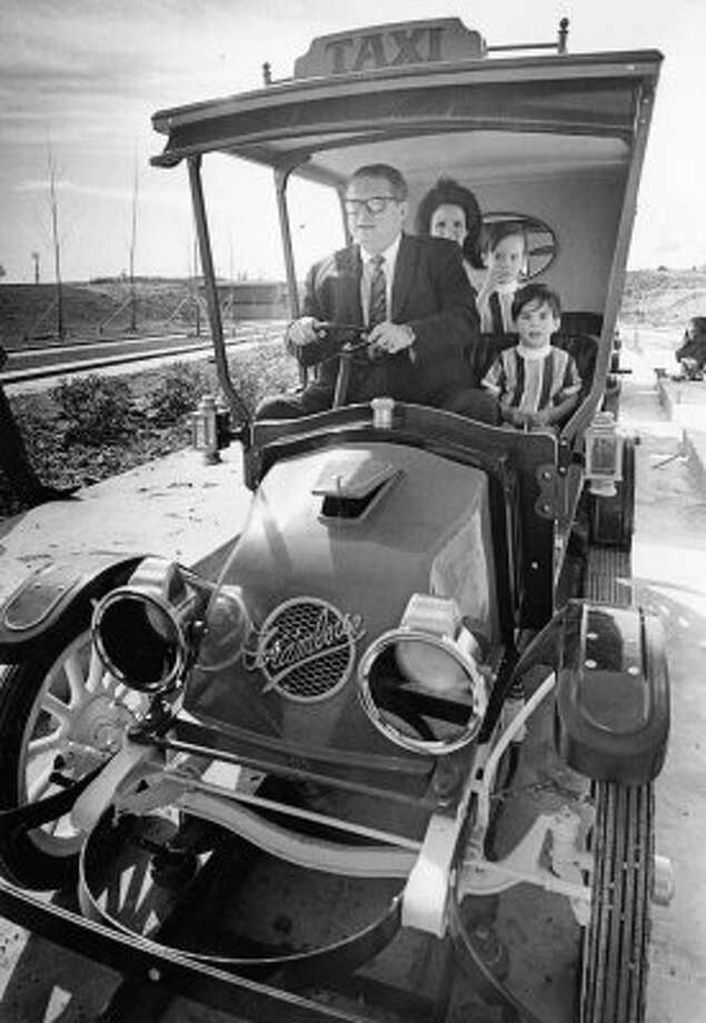 Astroworld builder Roy Hofheinz gives his daughter, Dene, and grandchildren Dinn Mann, front, and Scott Mann, 4, the first ride aboard this circa 1918 taxicab, one of a fleet of 35 being installed at the amusement park, Feb. 27, 1968. (Curtis McGee / Houston Chronicle file)