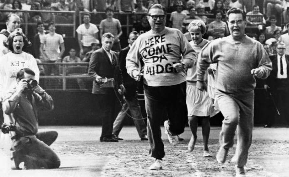Roy Hofheinz falls behind in a footrace with Houston Mayor Louie Welch, April 1969. The race was held in the Astrodome to publicize the Living Bank and radio station KILT's project to promote good health through jogging.  (Tom Colburn / Houston Chronicle file)