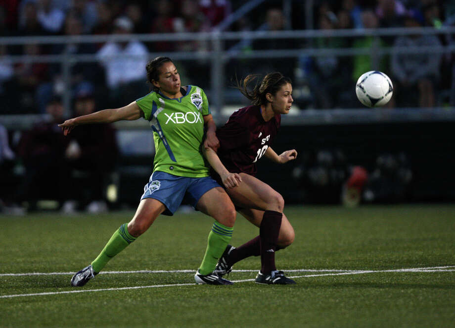 Seattle Sounders women player Veronica Perez and Seattle Pacific University player Demi Waitley try to control the ball during the Sounders women season opener on Monday, April 9, 2012 at Starfire Sports Stadium in Tukwila. Photo: JOSHUA TRUJILLO / SEATTLEPI.COM