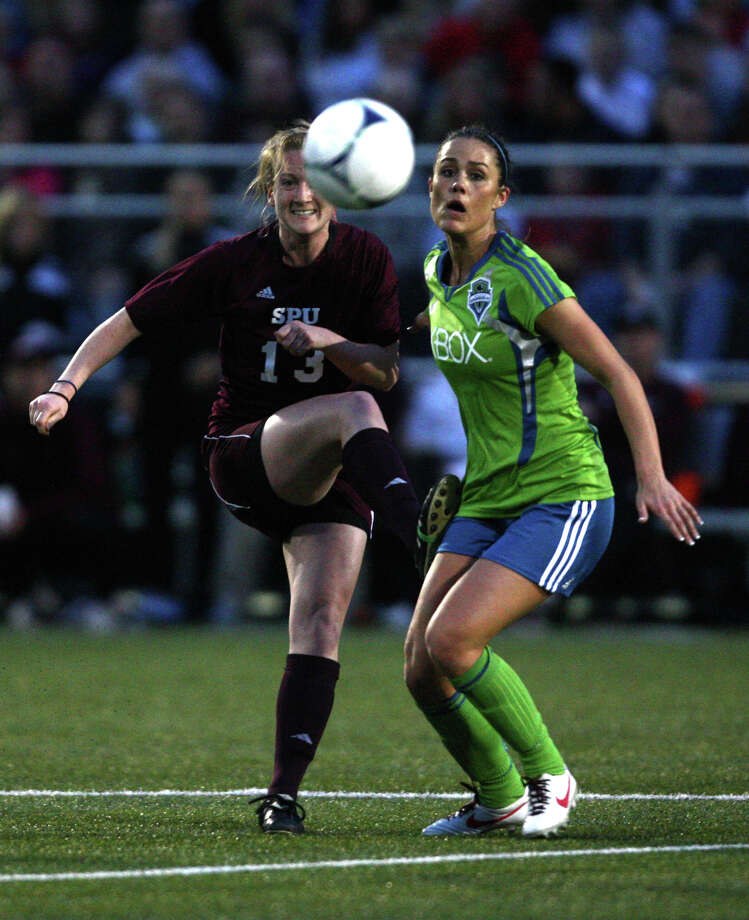 Seattle Sounders women player Kate Deines and Seattle Pacific University player Megan Lindsay battle for control of the ball during the Sounders women season opener on Monday, April 9, 2012 at Starfire Sports Stadium in Tukwila. Photo: JOSHUA TRUJILLO / SEATTLEPI.COM