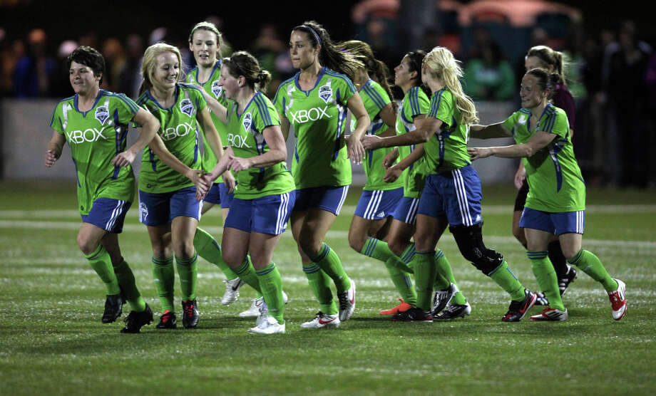 Seattle Sounders women players celebrate after a goal against Seattle  Pacific University on Monday, April 9, 2012 at Starfire Sports Stadium in Tukwila. Photo: JOSHUA TRUJILLO / SEATTLEPI.COM
