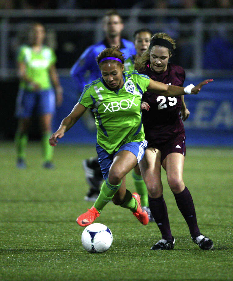 Seattle Sounders women player Sydney Leroux tangles with Seattle Pacific University player Brittany Langdon during the Sounders women season opener on Monday, April 9, 2012 at Starfire Sports Stadium in Tukwila. Photo: JOSHUA TRUJILLO / SEATTLEPI.COM