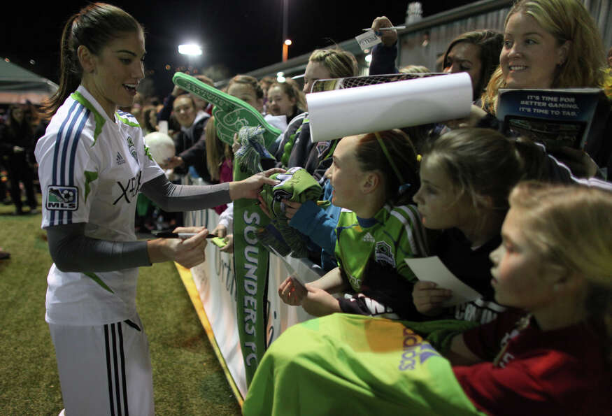 Seattle Sounders player Hope Solo signs autographs during the Sounders women season opener on Monday