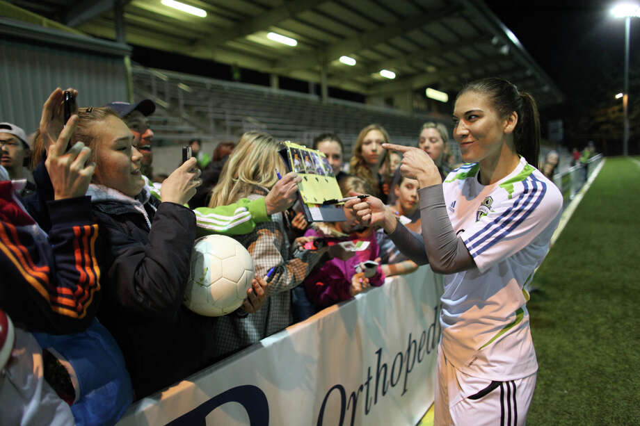 Seattle Sounders player Hope Solo signs autographs during the Sounders women season opener on Monday, April 9, 2012 at Starfire Sports Stadium in Tukwila. Photo: JOSHUA TRUJILLO / SEATTLEPI.COM